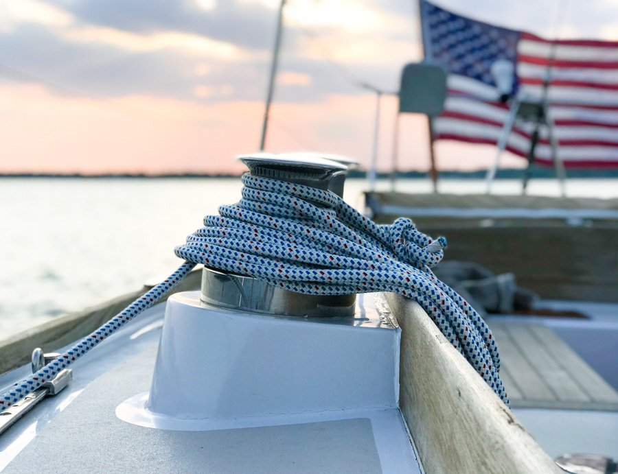 beautiful blue and white line on a winch with an american flag in the background.