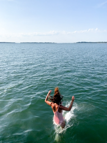 A woman jumping into the water